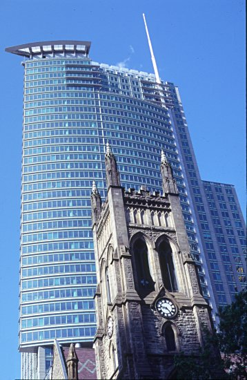 church and modern building in Montreal