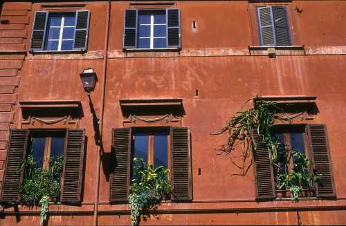 Facade of an old house in Rome (Italy)